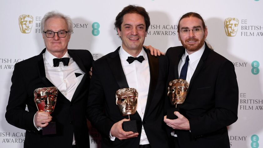"""Claude La Haye, Sylvain Bellemare and Bernard Gariépy Strobl after winning the award for Best Sound for """"Arrival"""" at the 2017 British Academy Film Awards in London earlier this month"""