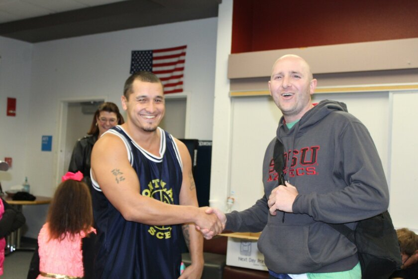 Ramona High 2001 graduates Michael Rivera, left, and Rich Holmes reminisce before a previous alumni basketball game.