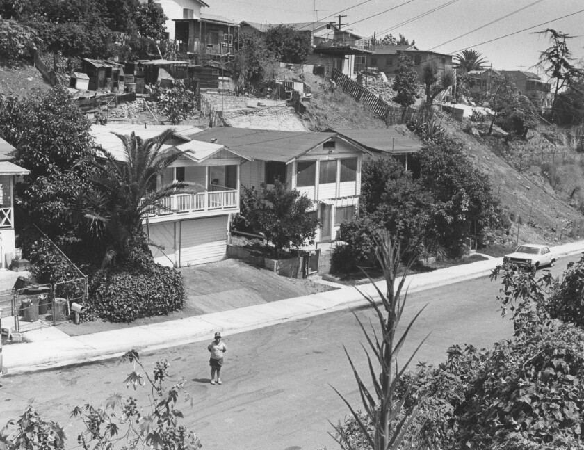 The house behind the boy is 812 N. Record Ave. in East Los Angeles, where Times reporter George Ramos grew up.