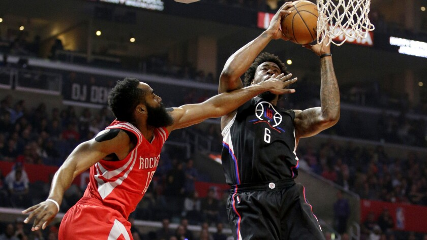 Clippers center DeAndre Jordan is fouled by Rockets forward James Harden in the first half Saturday.