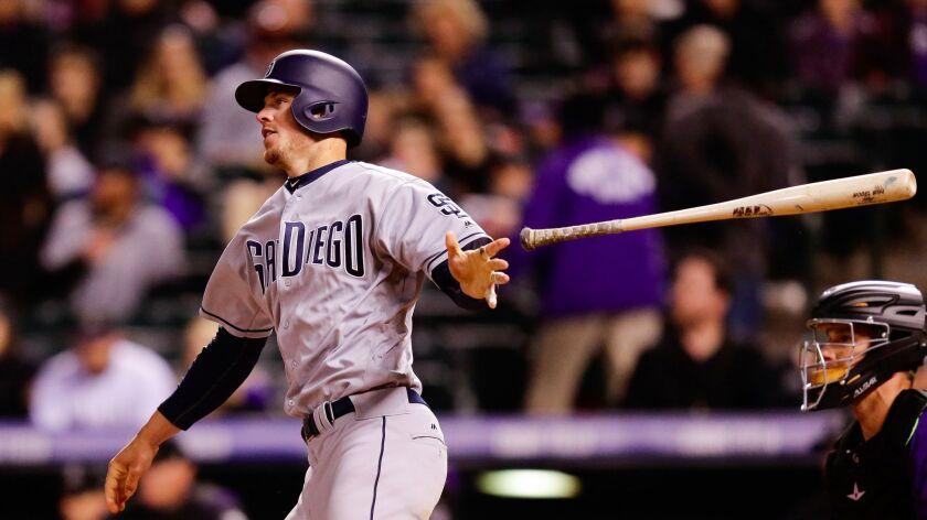 Apr 10, 2017; Denver, CO, USA; San Diego Padres first baseman Wil Myers (4) drops his bat on a tripl