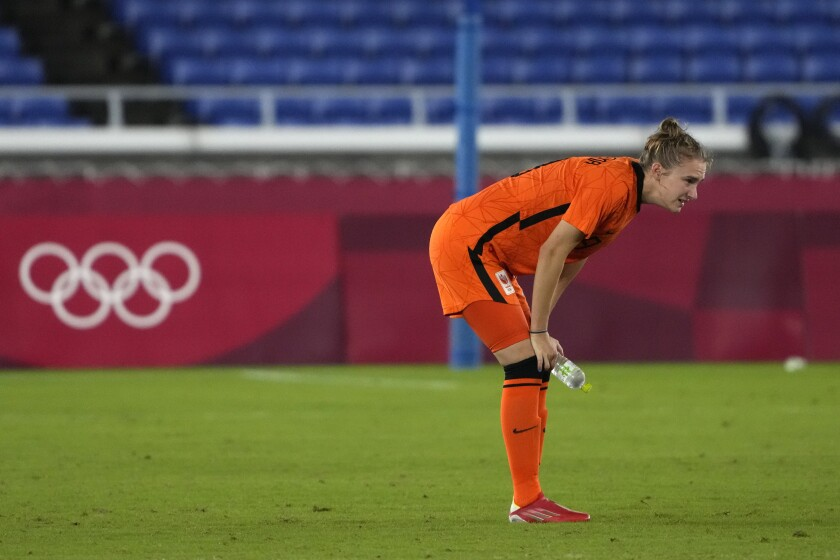 Netherlands' Vivianne Miedema reacts after loosing in a penalty shootout against United States during a women's quarterfinal soccer match at the 2020 Summer Olympics, Friday, July 30, 2021, in Yokohama, Japan. (AP Photo/Kiichiro Sato)