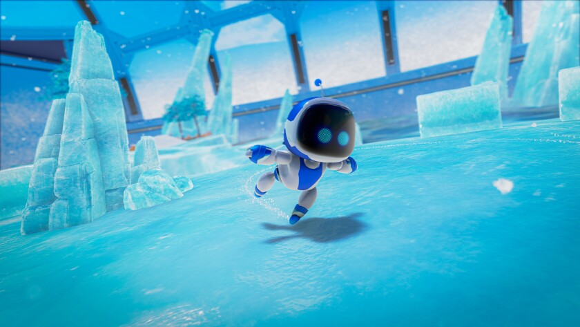 "A screen shot of ""Astro's Playroom"" with the title robot exploring an icy environment."