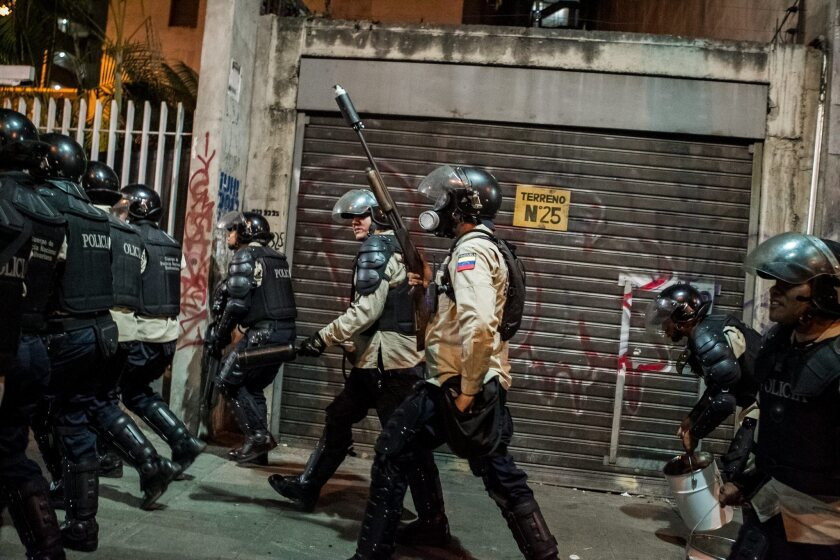 Venezuelan officials and opposition to meet after weeks of protests
