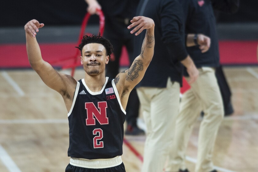 Nebraska's Trey McGowens celebrates a three-point basket he made against Rutgers shortly before a timeout in the second half of an NCAA college basketball game Monday, March 1, 2021, in Lincoln, Neb. (Kenneth Ferriera/Lincoln Journal Star via AP)