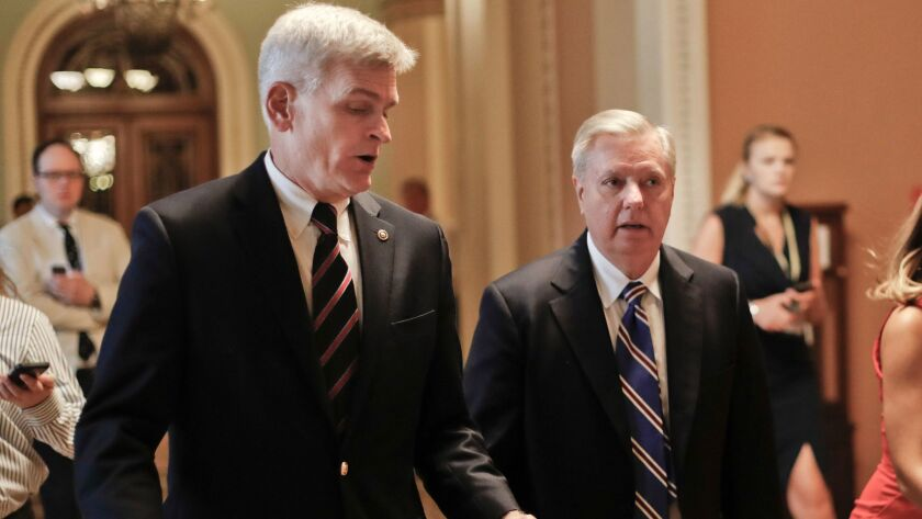 GOP Sens. Bill Cassidy of Louisiana, left, and Lindsey Graham of South Carolina confer on their last-minute measure to repeal the Affordable Care Act.