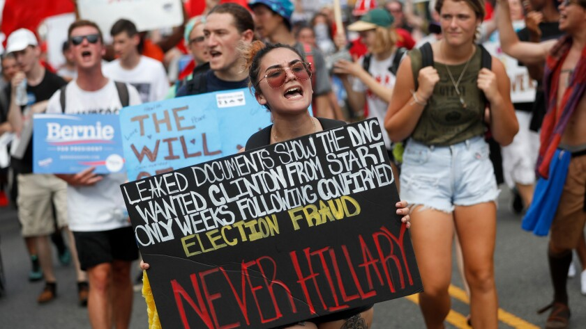 Supporters of Sen. Bernie Sanders protest in Philadelphia on Monday, July 25. On Sunday, Debbie Wasserman Schultz announced she would step down as DNC chairwoman at the end of the party's convention, after emails presumably stolen by hackers were publicly posted on the Internet.