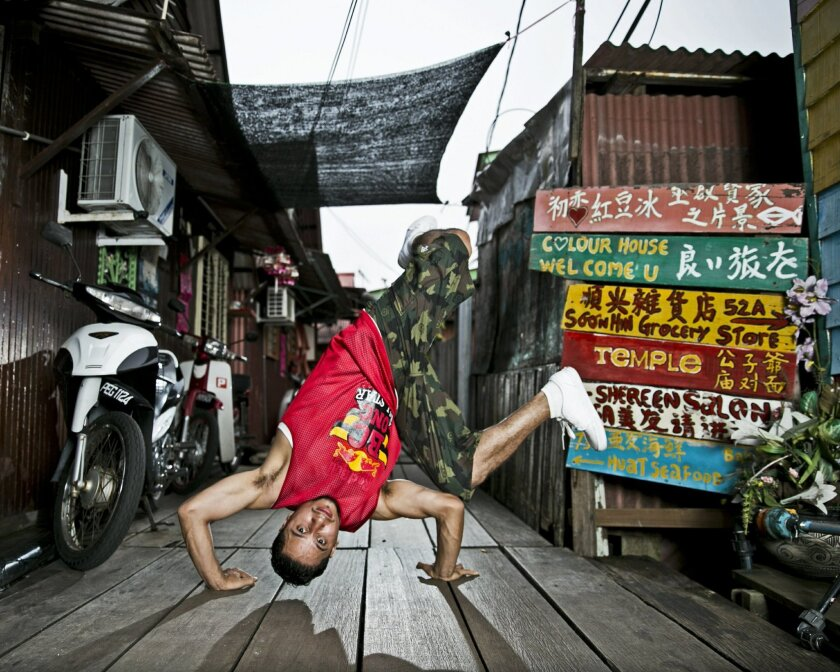 MUSIC_World champion San Diego break-dancer Omar RoxRite Delgado Macias break-dancing in June Chew Jetty, Penang, Malaysia. He was down there for the Red Bull BC One Cypher competition in Kuala Lumpur. Photo credit: Red Bull Content Pool Photo credit: Red Bull Content Pool