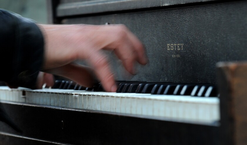 Someone plays piano.