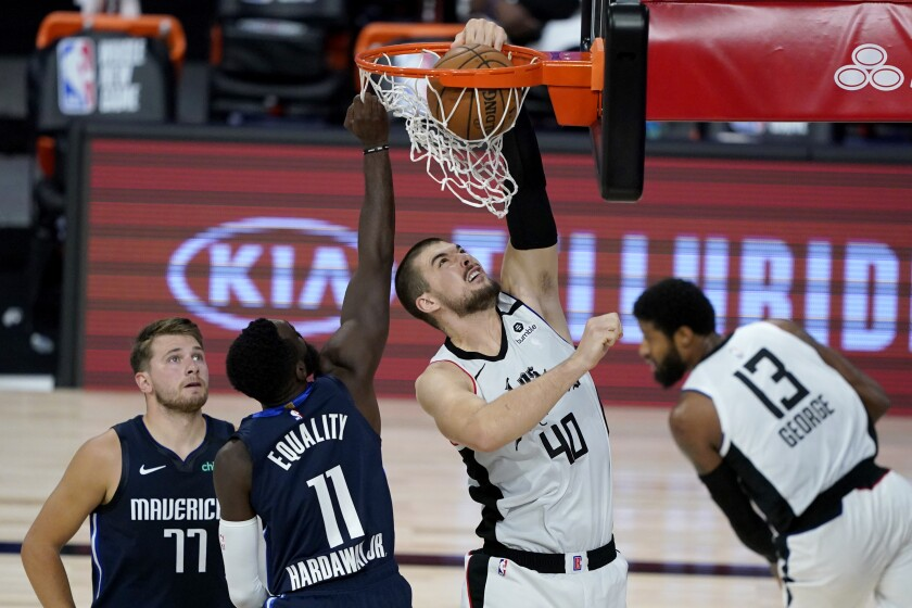 Clippers center Ivica Zubac dunks against the Mavericks on Thursday night.