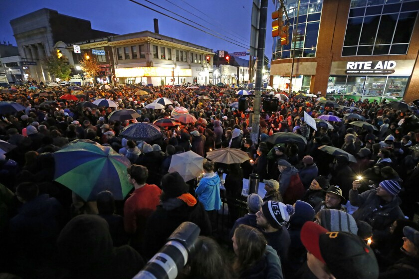 A crowd gathers in the Squirrel Hill section of Pittsburgh during a memorial vigil for the victims of Saturday's shooting.