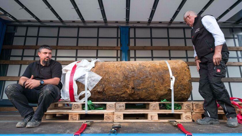 Bomb disposal experts Dieter Schwetzler, right, and Rene Bennert pose with a World War II-era bomb t