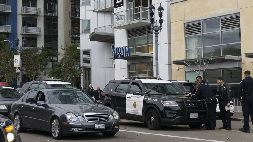 San Diego police converged on an apartment building in East Village early Monday after a shooting left one person critically injured.