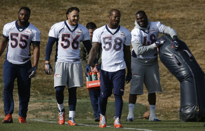 From left, Denver Broncos outside linebacker Lerentee McCray, linebacker Shane Ray, and outside linebackers Von Miller and Shaquil Barrett joke with each other during an NFL football practice at the team's headquarters Saturday, Jan. 30, 2016, in Englewood, Colo. The Broncos are preparing to face the Carolina Panthers in Super Bowl 50 on Sunday, Feb. 7, in Santa Clara, Calif. (AP Photo/David Zalubowski)