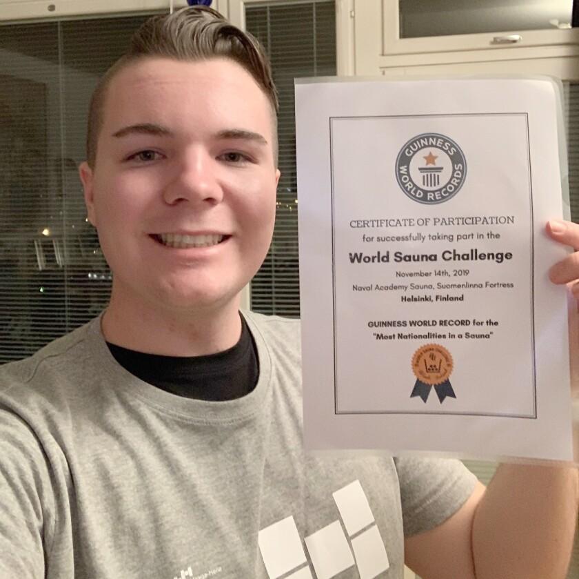 Copy - Tomi Holding Guinness Certificate.jpg