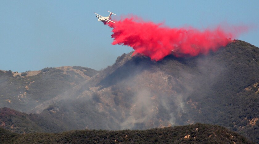 Tankers drops retardant during an aerial assault on a brush fire that has broken out in the area of Montecito Peak near Santa Barbara Thursday morning.