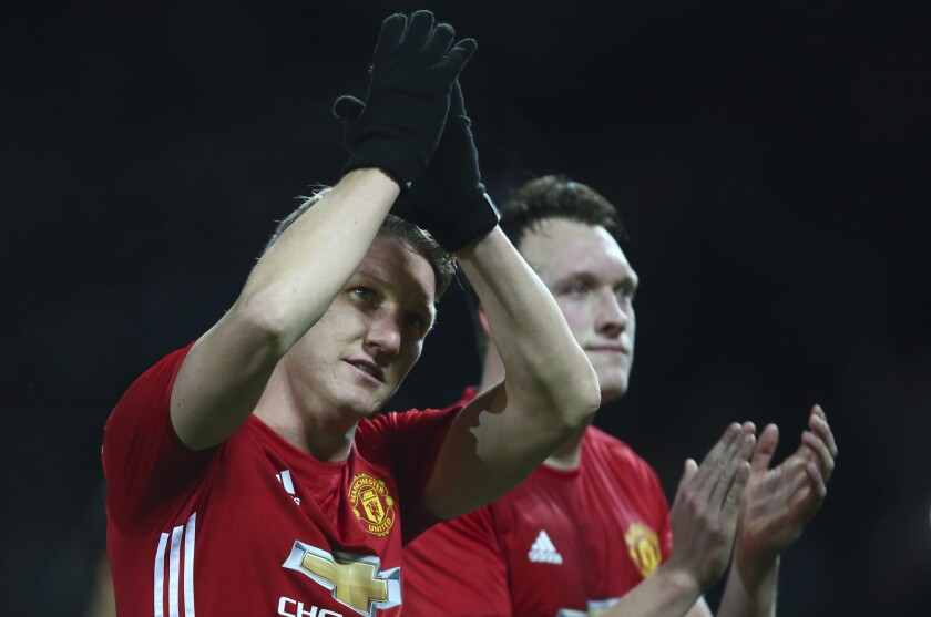 Manchester United's Bastian Schweinsteiger waves to the crowd as he walks off the pitch after the end of the English League Cup quarterfinal soccer match between Manchester United and West Ham United at Old Trafford in Manchester, England Wednesday, Nov. 30, 2016. Man United won the game 4-1. (AP Photo/Dave Thompson)
