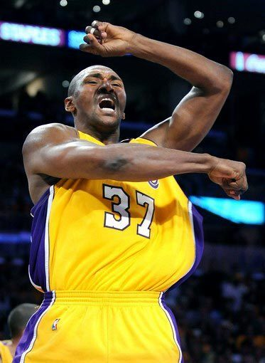 Lakers forward Ron Artest, who finished with 15 points, celebrates after blocking a shot by Celtics power forward Glen Davis in the fourth quarter of Game 1 on Thursday night.