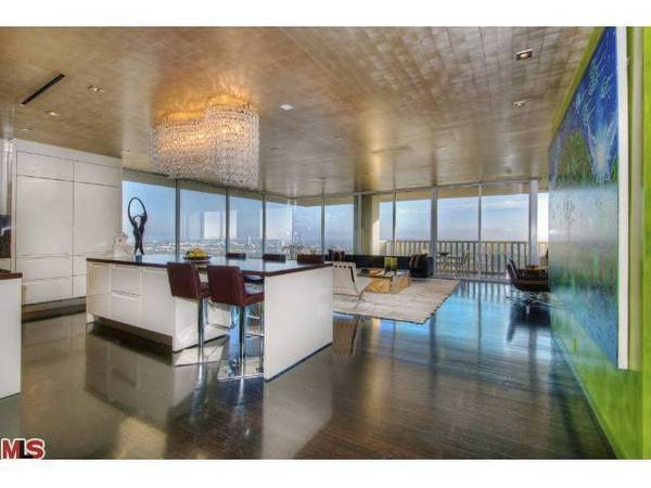 Walls of glass bring city views into the 20th floor unit.