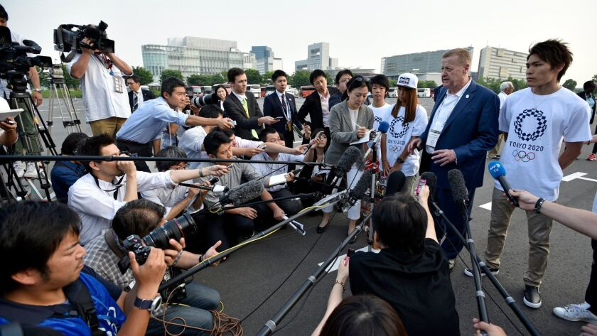 International Olympic Committee executive John Coates speaks to reporters after visiting the future construction site of the Aomi Urban Sports Venue in Tokyo on Wednesday.