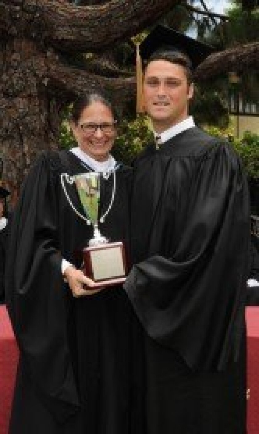 Steven Hinshaw of Del Mar receives The Bishop's School's most prestigious award, the Michael W. Teitelman Loyalty Cup, from Head of School Aimeclaire Roche.
