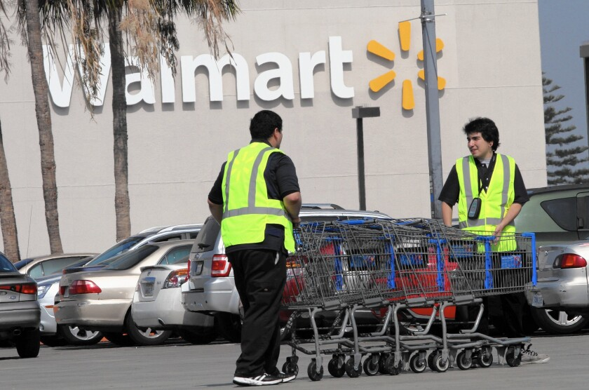 Starting in April, about 500,000 Wal-Mart employees will get a raise to the new level — $1.75 an hour more than the federal minimum wage.