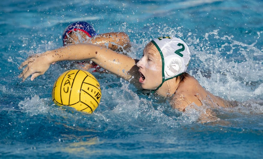 Edison's Cameron Davidson breaks for the goal against Los Alamitos's Daniel Mori during a Wave Leagu