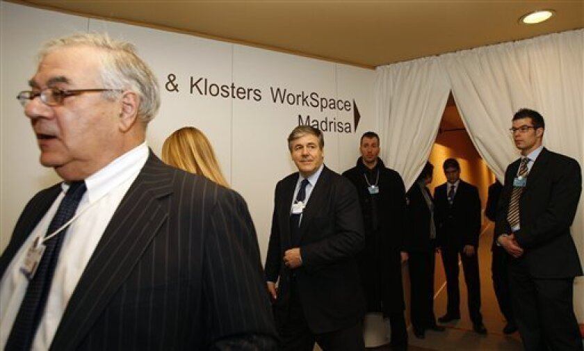 Chairman of the Management Board of Deutsche Bank, Germany, Josef Ackermann, center, exits after a meeting of bankers at the World Economic Forum in Davos, Switzerland on Saturday Jan. 30, 2010. Standing left is Chairman of the Financial Services Committee, USA, Barney Frank. (AP Photo/Virginia Mayo)