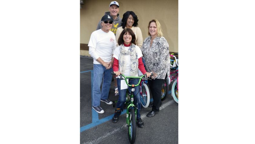 Bike Angels founder Elaine Pease, front center, was supported by former Burbank Park Board member Te