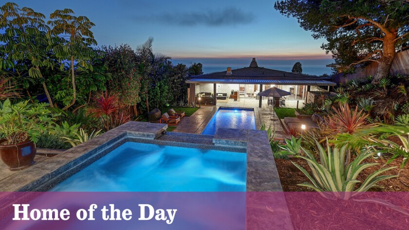 A waterfall fountain cascades toward the swimming pool at the onetime Palos Verdes Estates home of former L.A. Laker Sasha Vujacic.