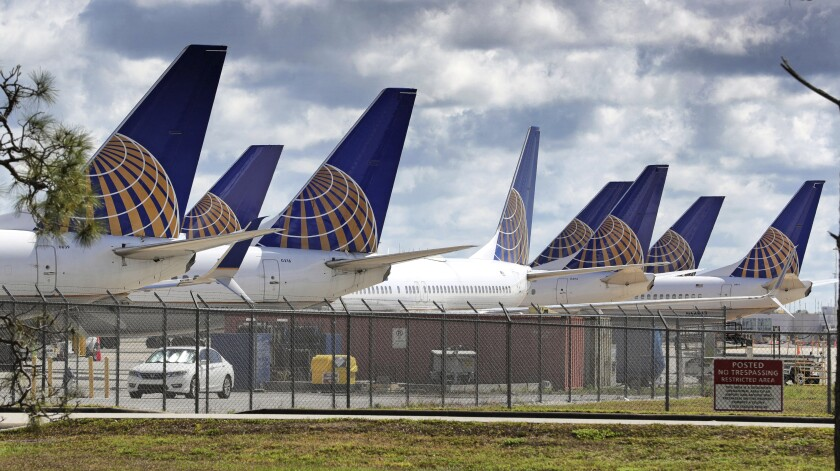 FILE - United Airlines planes are parked at Orlando International Airport, in a Tuesday, April 7, 2020 file photo, in Orlando, Fla. United Airlines said Tuesday, July 21 that it lost $1.63 billion in the second quarter as revenue plunged 87%, and it will operate at barely over one-third of capacity through September as the coronavirus throttles air travel. (Joe Burbank/Orlando Sentinel via AP, File)