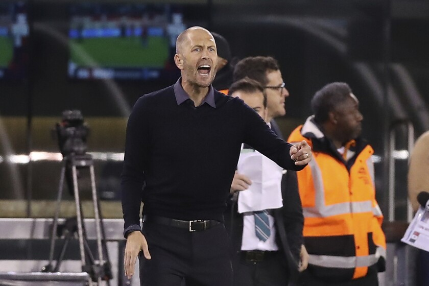 FILE - In this Friday, Sept. 6, 2019 file photo, United States head coach Gregg Berhalter shouts instructions to his team during an international friendly soccer match against the Mexico in East Rutherford, N.J. United States coach Gregg Berhalter is optimistic his team will train in Doha at some point before that nation hosts the 2022 World Cup. The American men U.S. planned to train at the Aspire Academy from Jan. 5-25 but the U.S. Soccer Federation called off the trip after a U.S. military air strike killed a top Iranian military commander. The camp was relocated to IMG Academy in Bradenton, Florida, where the team held a two-hour workout on Tuesday, Jan. 7, 2020. (AP Photo/Steve Luciano, File)