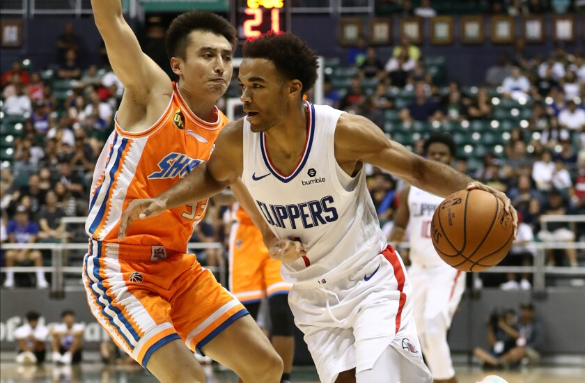 Clippers guard Jerome Robinson drives past Luo Hanchen of the Shanghai Sharks during an exhibition Sunday in Honolulu.