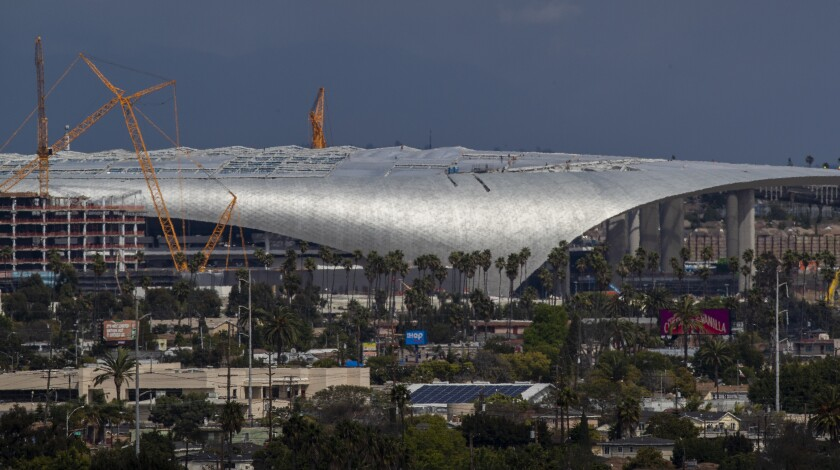 Construction continues at SoFi Stadium in Inglewood, where the Rams and Chargers will be playing on March 19.