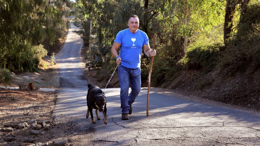 Doug Siverly and his dog Lacy walk along a rural road near his home on one his daily morning walks.