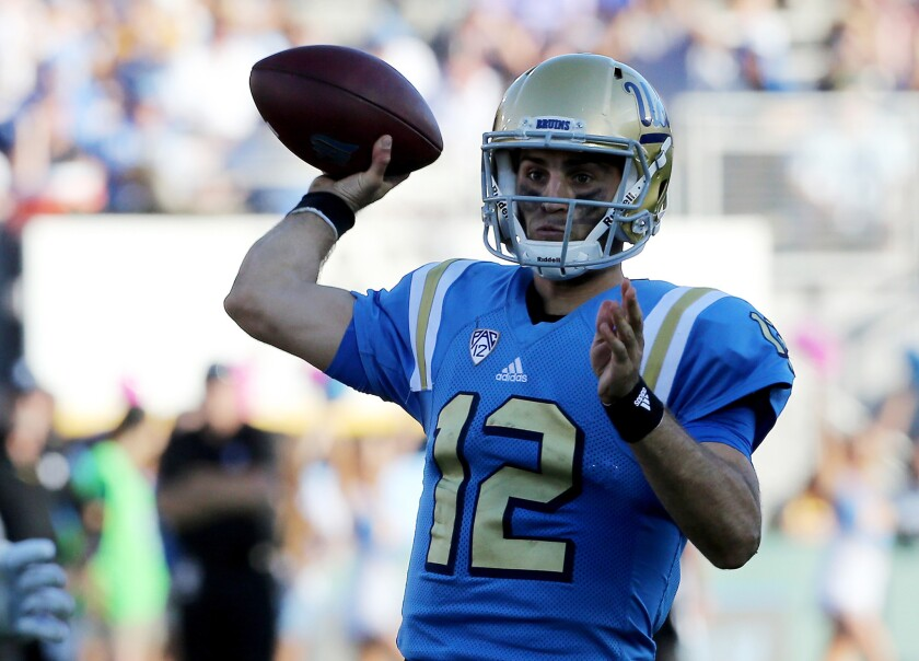UCLA quarterback Mike Fafaul throws a pass against Utah in the fourth quarter on Oct. 22.