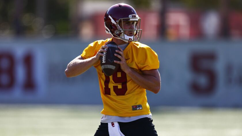 LOS ANGELES, CALIF. - AUGUST 03: USC Trojans quarterback Matt Fink (19) passes during drills as the