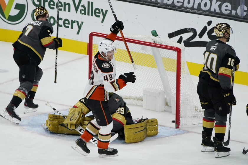 Anaheim Ducks center Isac Lundestrom (48) celebrates after left wing Max Comtois scored against the Vegas Golden Knights during the third period of an NHL hockey game Thursday, Feb. 11, 2021, in Las Vegas. (AP Photo/John Locher)
