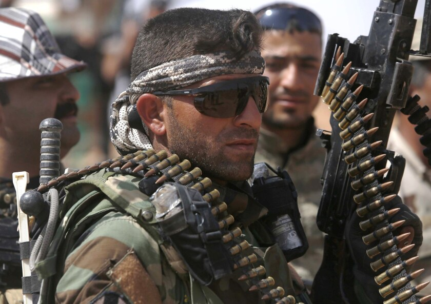 An Iraqi fighter with the Shiite Muslim Al Abbas militia unit near the village of Nukhayb in embattled Anbar province west of Baghdad on May 19.