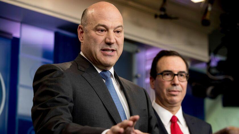 National Economic Director Gary Cohn, left, accompanied by Treasury Secretary Steve Mnuchin, speaks