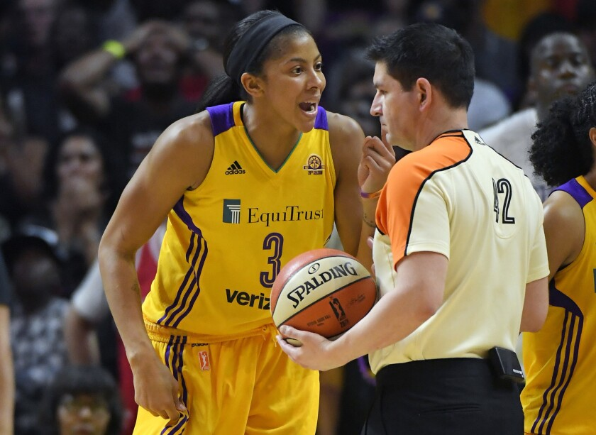 Sparks forward Candace Parker complains about a call to referee Roy Gulbeyan during the second half in Game 4 of the WNBA Finals on Sunday.