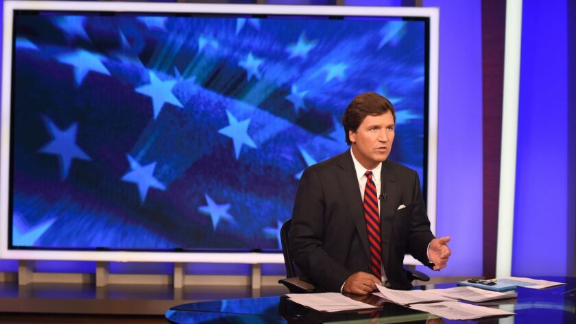 Tucker Carlson on the set of his Fox News show at the network's studios in New York in October 2018.