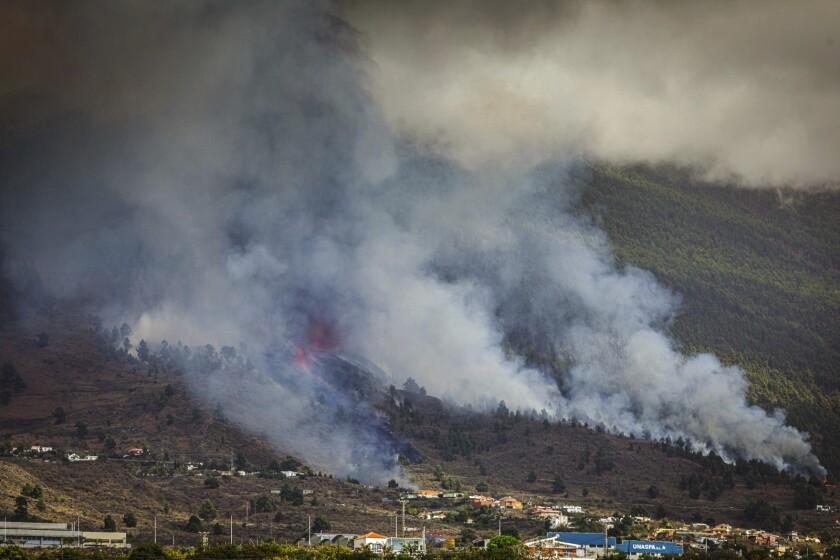Smoke rises at the Cumbre Viegja volcano on the island of La Palma.