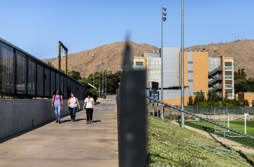 Students walk on the UC Riverside campus on July 15.