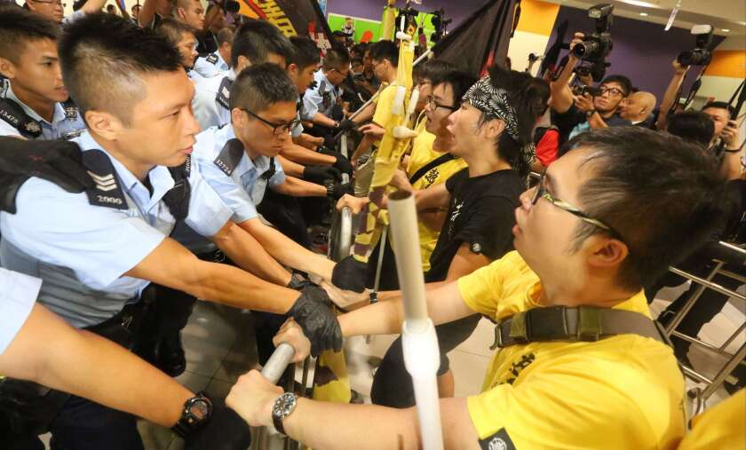 Protesters detain a man they say is a Chinese undercover agent during a demonstration at the Hong Kong airport on Aug. 13, 2019.