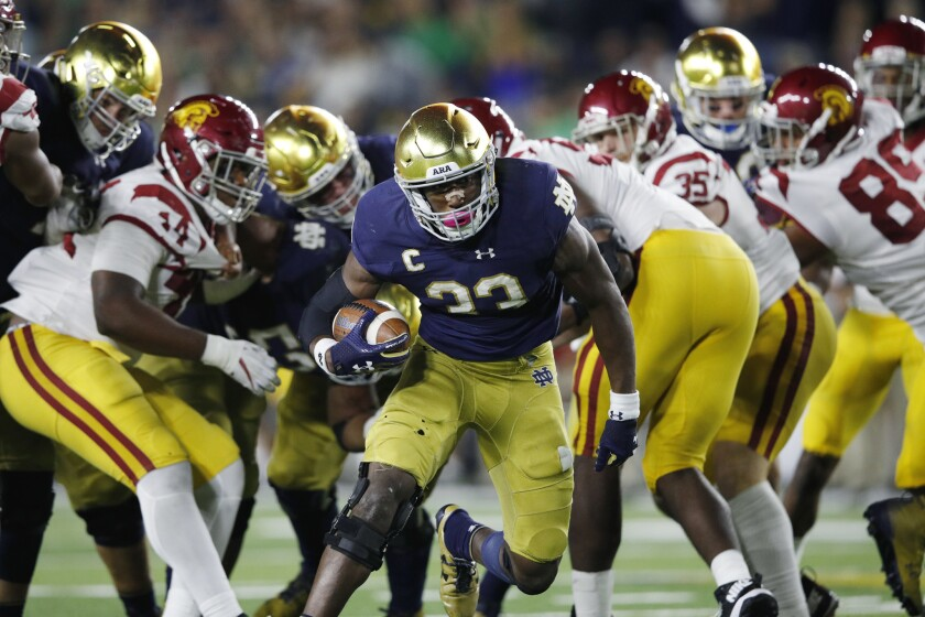Notre Dame running back Josh Adams breaks into the clear on a 14-yard touchdown run in the fourth quarter against USC last season in South Bend, Ind. The Trojans and Irish will meet for the 90th time this Saturday at the Coliseum.