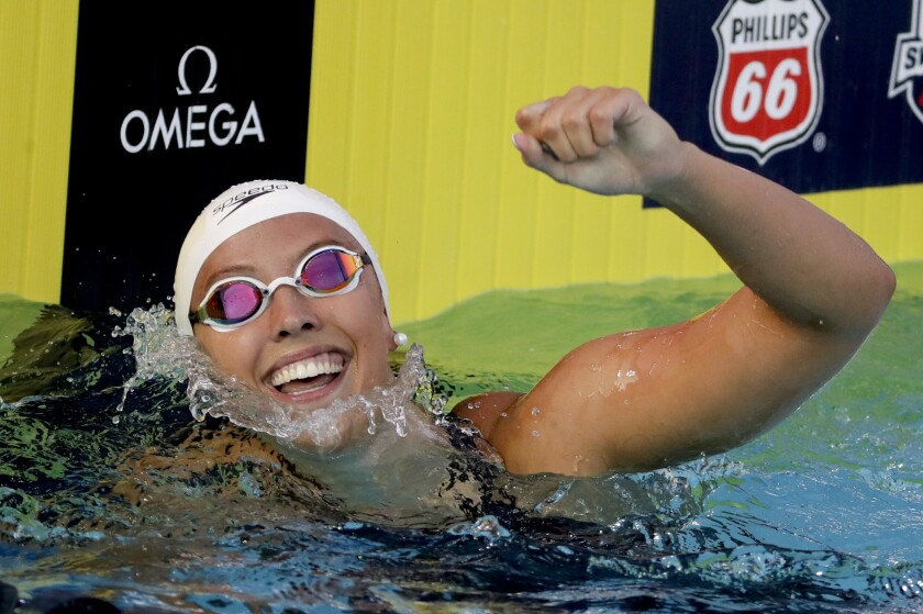 Kathleen Baker celebrates after her world record in the women's 100-meter backstroke final at the U.S. national championships swimming meet Saturday, July 28, 2018, in Irvine, Calif. (AP Photo/Chris Carlson)