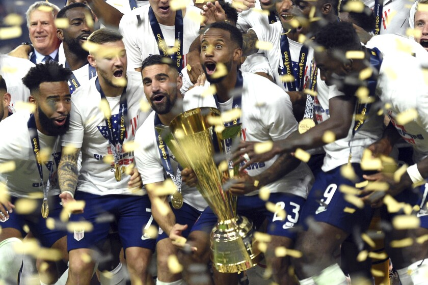 United States celebrate their extra-time victory over Mexico in the CONCACAF Gold Cup final soccer match Sunday, Aug. 1, 2021, in Las Vegas. (AP Photo/David Becker)