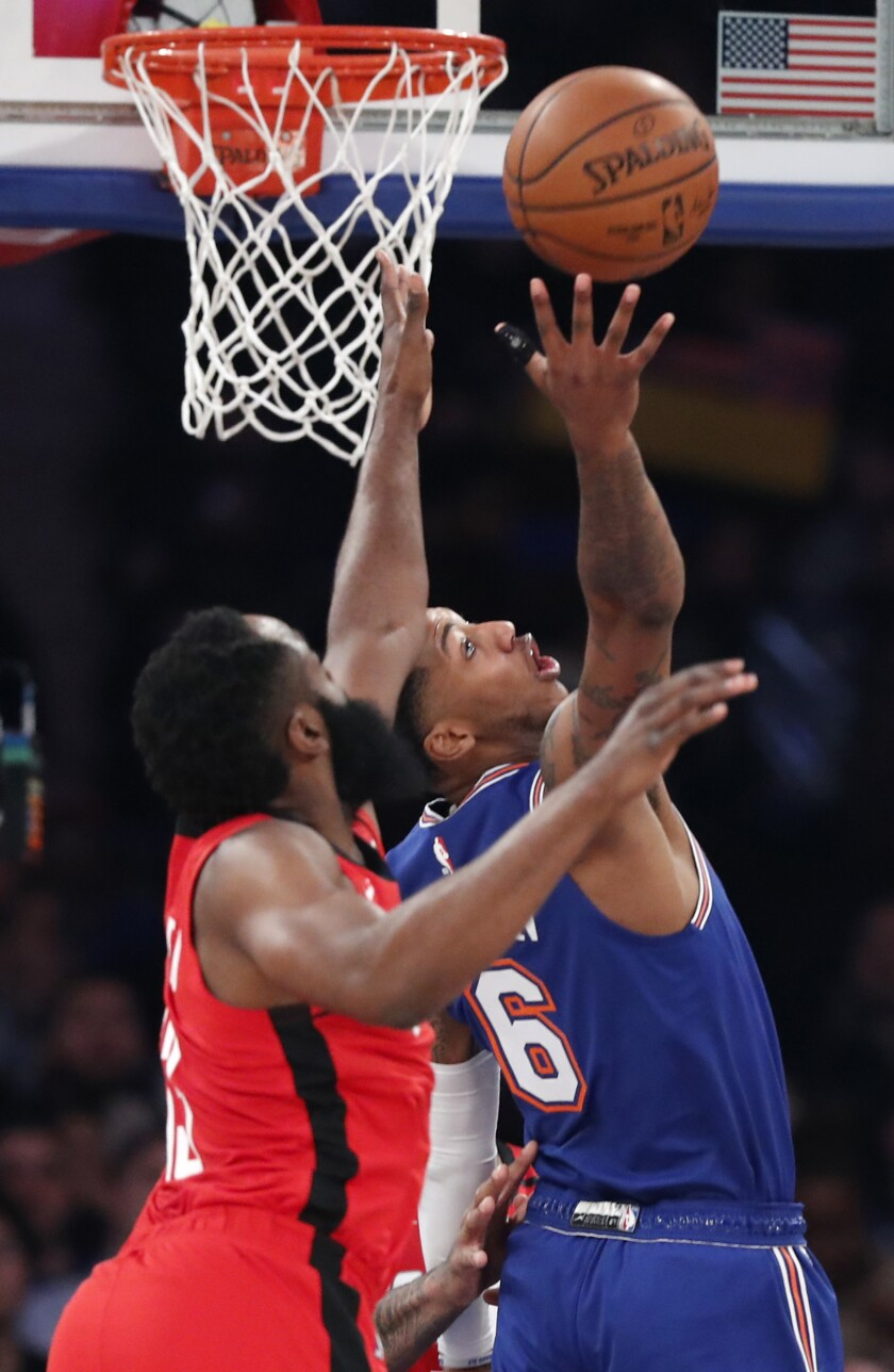 Houston Rockets guard James Harden, left, pressures New York Knicks guard Elfrid Payton (6) during the first quarter of an NBA basketball game in New York, Monday, March 2, 2020. (AP Photo/Kathy Willens)