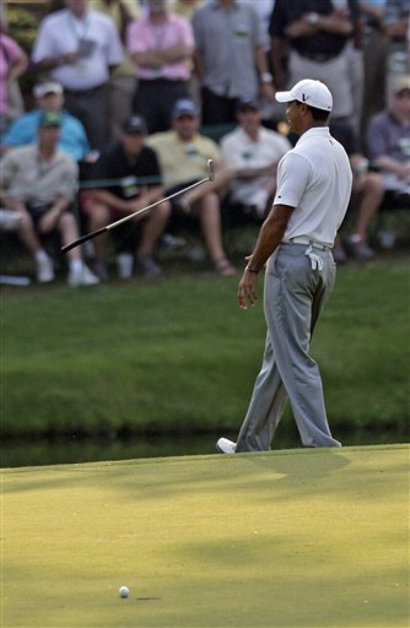 Tiger Woods flips his club after missing an eagle putt on the 15th hole during the second round of the Masters golf tournament Friday, April 8, 2011, in Augusta, Ga. (AP Photo/David J. Phillip)